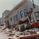 Photo of building collapsing due to damage from Loma Prieta earthquake.