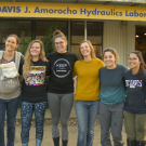 Photo of six women standing in front of the UC Davis J Amorocho Hydraulics Laboratory